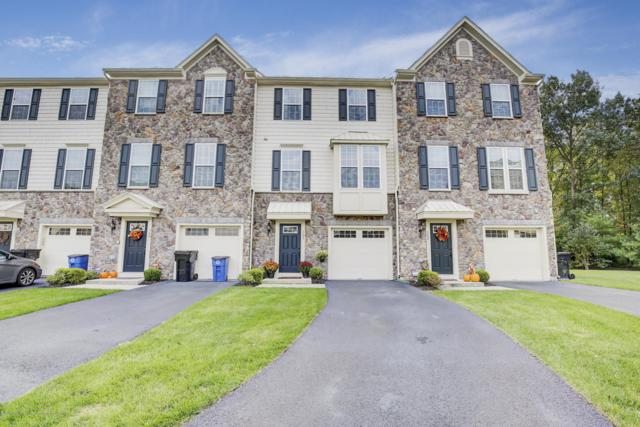 103 Phillip E Frank Way #103, Cliffwood, NJ 07721 (MLS #21842380) :: The MEEHAN Group of RE/MAX New Beginnings Realty