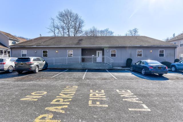 300 Bridge Plaza Drive, Manalapan, NJ 07726 (MLS #21915764) :: The MEEHAN Group of RE/MAX New Beginnings Realty