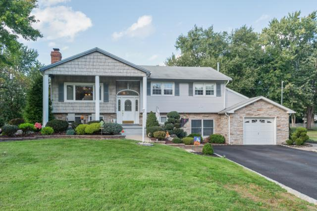 12 Greenleaf Drive, Manalapan, NJ 07726 (MLS #21916170) :: The MEEHAN Group of RE/MAX New Beginnings Realty
