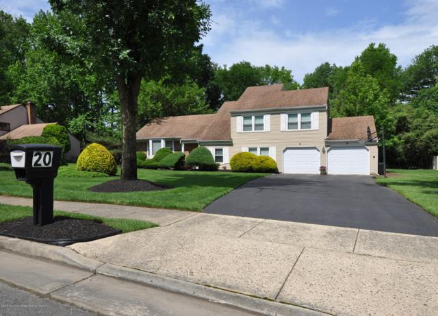 20 Woodland Circle, Manalapan, NJ 07726 (MLS #21929794) :: The MEEHAN Group of RE/MAX New Beginnings Realty
