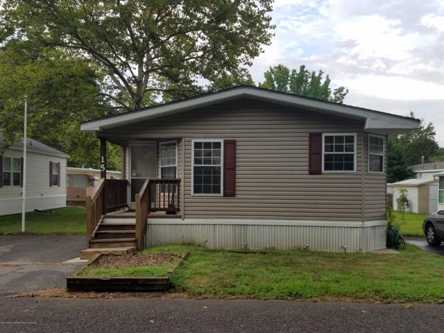 15 Village Road, Morganville, NJ 07751 (MLS #21931527) :: The MEEHAN Group of RE/MAX New Beginnings Realty