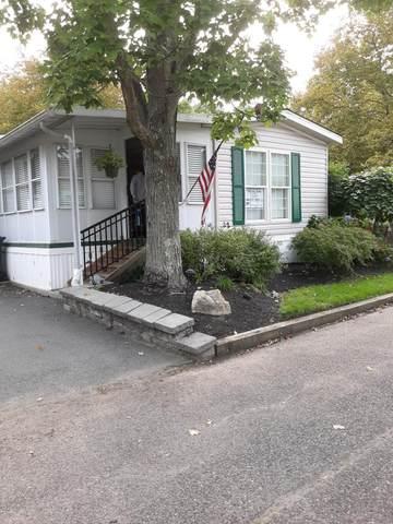 32 Village Road, Morganville, NJ 07751 (MLS #22033617) :: The MEEHAN Group of RE/MAX New Beginnings Realty
