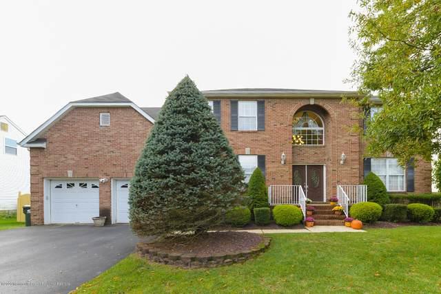 18 Peregrine Drive, Morganville, NJ 07751 (MLS #22038062) :: The Sikora Group