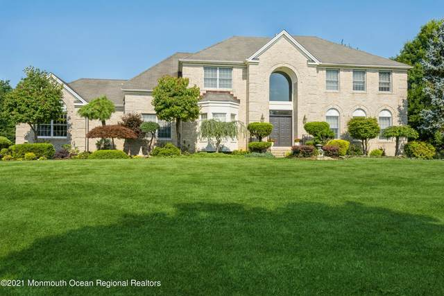 212 Navajo Court, Morganville, NJ 07751 (MLS #22124871) :: The MEEHAN Group of RE/MAX New Beginnings Realty