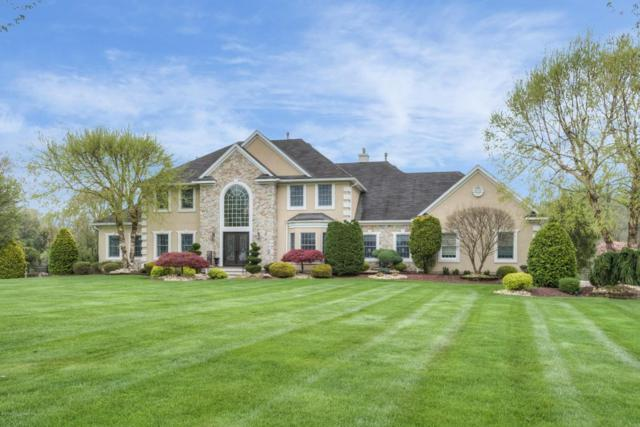 511 Apache Trail, Morganville, NJ 07751 (MLS #21716044) :: The Dekanski Home Selling Team