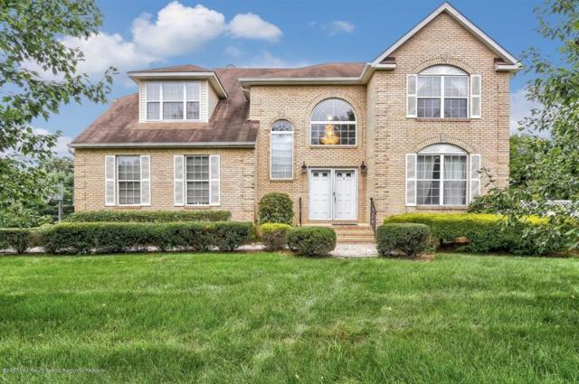 2 Regal Drive, Morganville, NJ 07751 (MLS #21731582) :: The Dekanski Home Selling Team