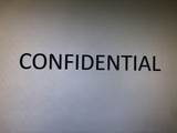999 Confidential - Photo 1