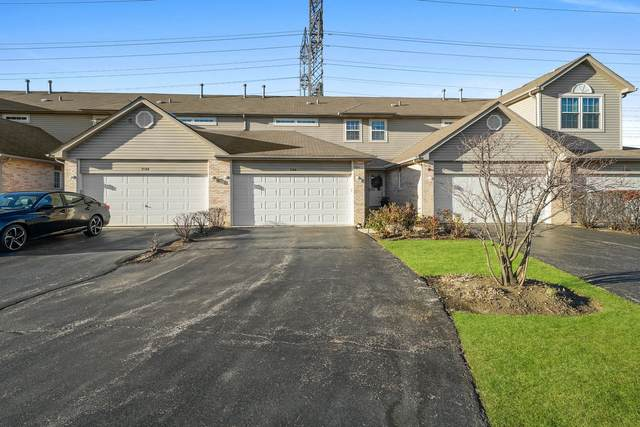 2106 W Adobe Drive #2106, Addison, IL 60101 (MLS #10946736) :: Jacqui Miller Homes