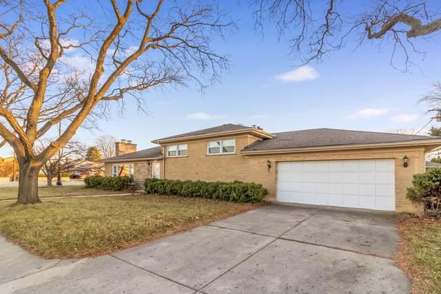 4001 W Estes Avenue, Lincolnwood, IL 60712 (MLS #10947749) :: Schoon Family Group