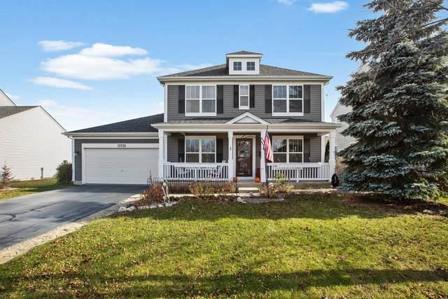 11576 Heritage Lane, Huntley, IL 60142 (MLS #10948211) :: Schoon Family Group