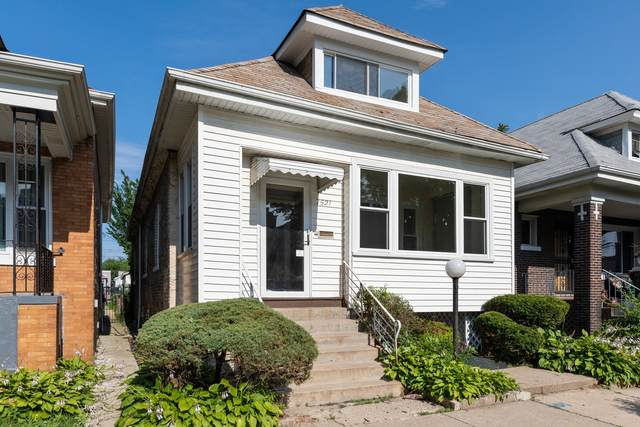 7521 S Eberhart Avenue, Chicago, IL 60619 (MLS #10977203) :: Schoon Family Group