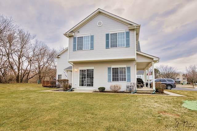 1054 Castleshire Drive, Woodstock, IL 60098 (MLS #11003662) :: Lewke Partners