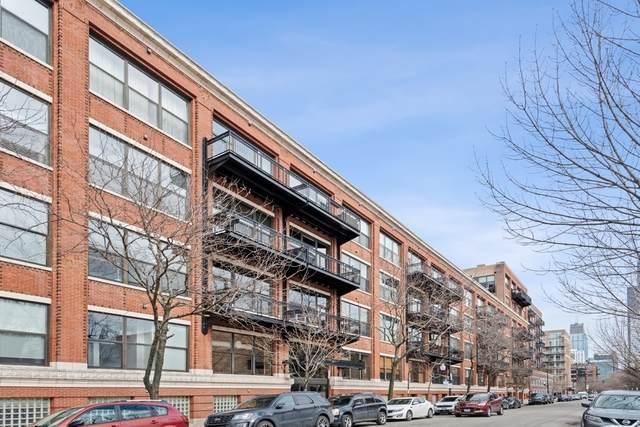 1040 W Adams Street #118, Chicago, IL 60607 (MLS #11014942) :: Littlefield Group