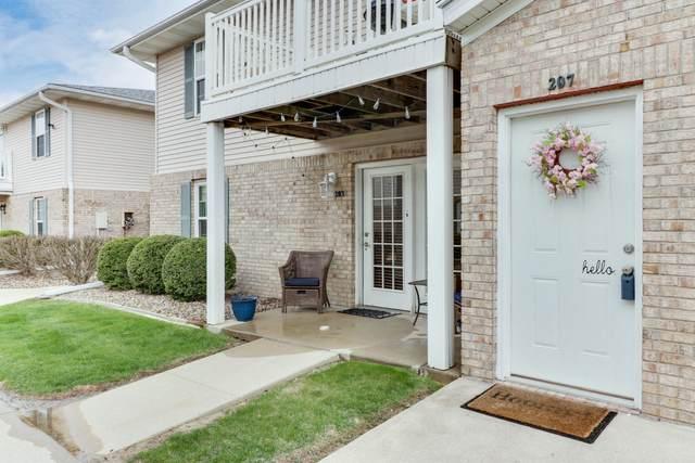 1040 Ekstam Drive #207, Bloomington, IL 61704 (MLS #11049965) :: Helen Oliveri Real Estate