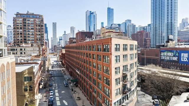 411 W Ontario Street #101, Chicago, IL 60654 (MLS #11050401) :: Schoon Family Group
