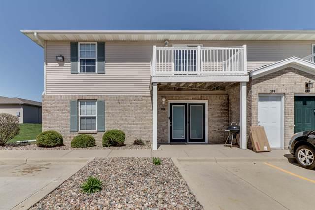 1040 Ekstam Drive #202, Bloomington, IL 61704 (MLS #11052042) :: O'Neil Property Group