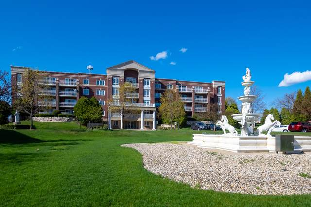 7021 W Touhy Avenue #308, Niles, IL 60714 (MLS #11055544) :: Littlefield Group