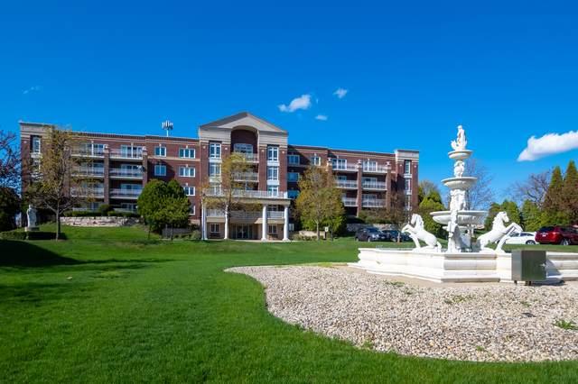 7021 W Touhy Avenue #308, Niles, IL 60714 (MLS #11055544) :: Helen Oliveri Real Estate