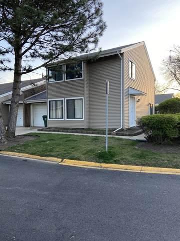 1424 N Whispering Springs Circle #1, Palatine, IL 60074 (MLS #11058371) :: Helen Oliveri Real Estate