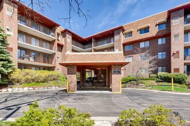 101 Old Oak Drive #202, Buffalo Grove, IL 60089 (MLS #11090975) :: Helen Oliveri Real Estate