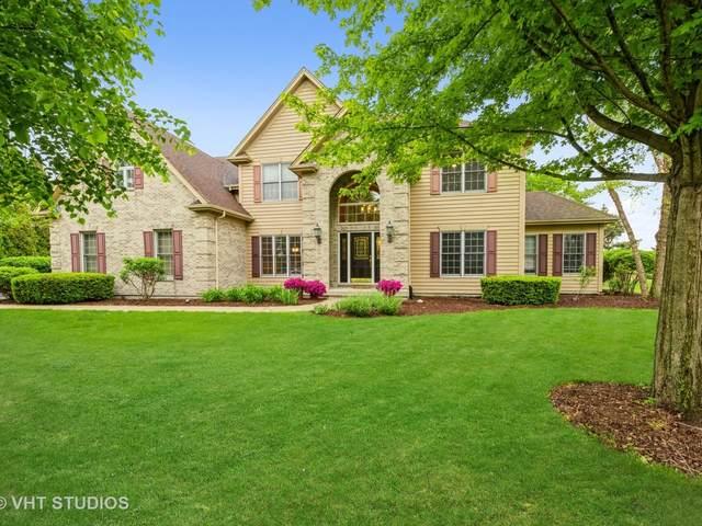 9445 Nicklaus Lane, Lakewood, IL 60014 (MLS #11096107) :: BN Homes Group