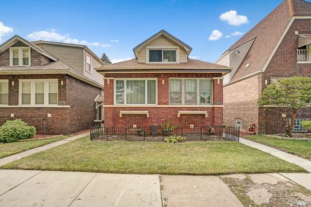 8034 S Woodlawn Avenue, Chicago, IL 60619 (MLS #11242659) :: John Lyons Real Estate