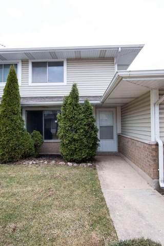 1411 Fremont Drive 9-2, Hanover Park, IL 60133 (MLS #11254549) :: Ani Real Estate