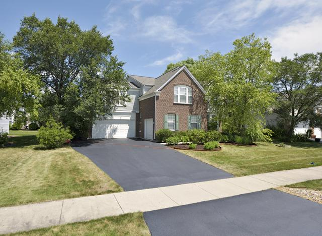 24656 Woodstock Drive, Plainfield, IL 60585 (MLS #09730173) :: Angie Faron with RE/MAX Ultimate Professionals