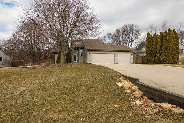 7961 Windspoint Road, Roscoe, IL 61073 (MLS #09883682) :: Littlefield Group