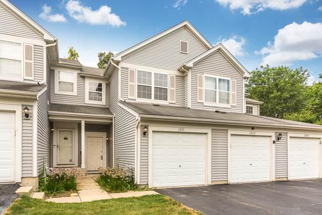 1311 Brookdale Drive, Carpentersville, IL 60110 (MLS #10487309) :: Suburban Life Realty