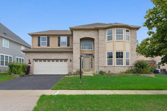 1710 N Woods Way, Vernon Hills, IL 60061 (MLS #10514316) :: Angela Walker Homes Real Estate Group