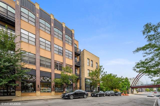 1815 N Milwaukee Avenue #201, Chicago, IL 60647 (MLS #10526926) :: LIV Real Estate Partners