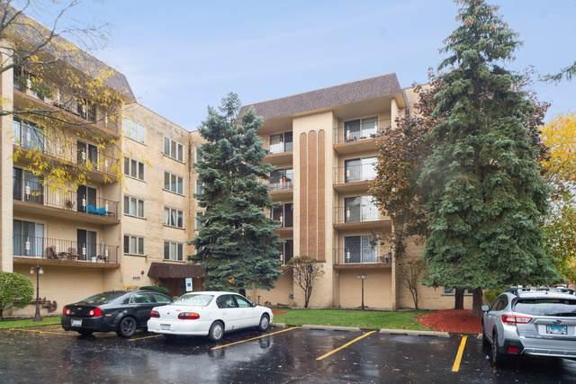 6455 W Belle Plaine Avenue #310, Chicago, IL 60634 (MLS #10569923) :: Baz Realty Network | Keller Williams Elite