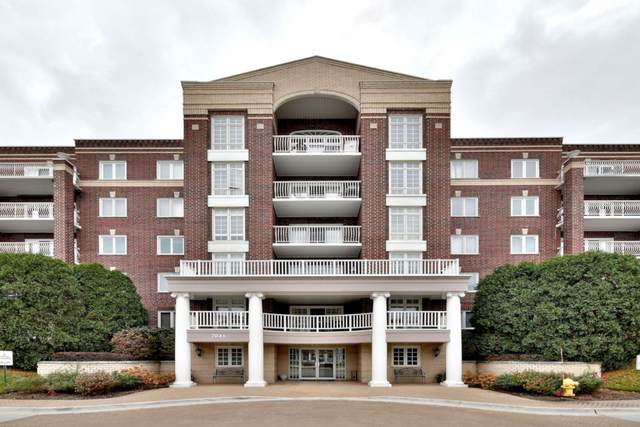 7041 W Touhy Avenue #206, Niles, IL 60714 (MLS #10570452) :: The Perotti Group | Compass Real Estate