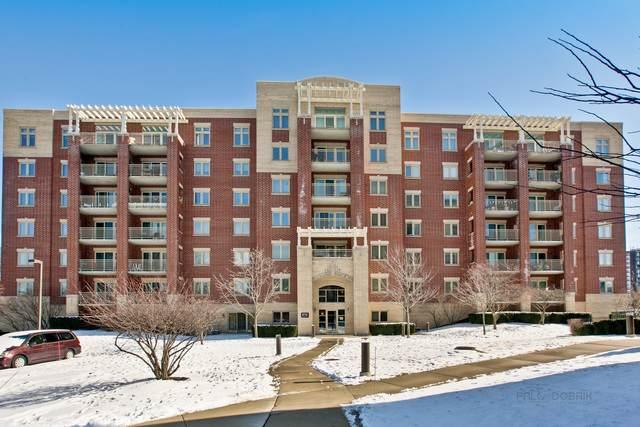 8711 W Bryn Mawr Avenue #408, Chicago, IL 60631 (MLS #10631757) :: Helen Oliveri Real Estate