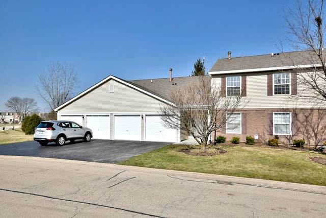302 Newport Lane B2, Bartlett, IL 60103 (MLS #10677354) :: Property Consultants Realty