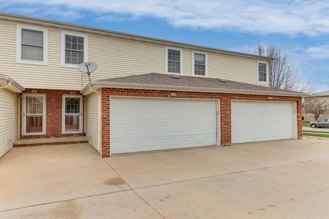 1104 Ekstam Drive 1104-2, Bloomington, IL 61704 (MLS #10684636) :: Century 21 Affiliated