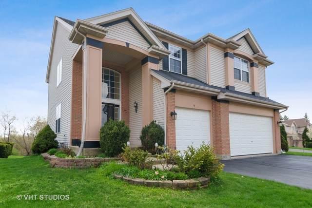 9 Prairie Pointe Lane, Streamwood, IL 60107 (MLS #10819233) :: John Lyons Real Estate