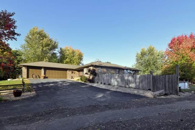 7713 N Winding Oak Lane, Stillman Valley, IL 61084 (MLS #10910021) :: Littlefield Group