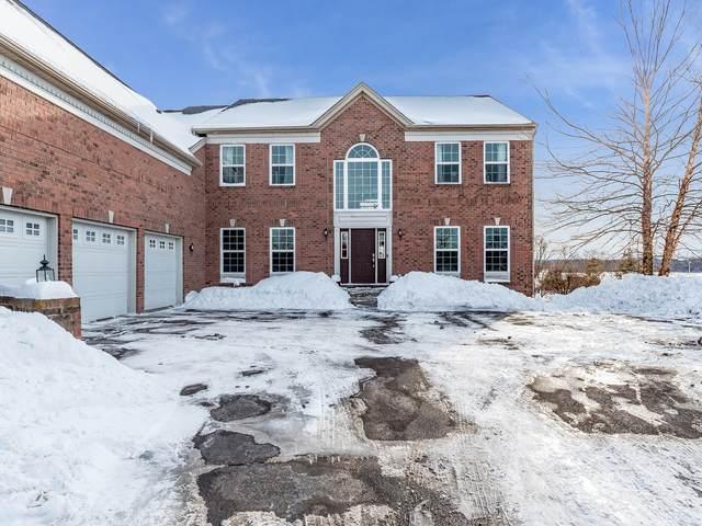 1128 Championship Drive, Elgin, IL 60124 (MLS #10999824) :: Jacqui Miller Homes