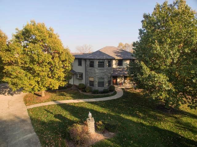 1305 Walnut Creek Court, Mahomet, IL 61853 (MLS #10401419) :: Lewke Partners