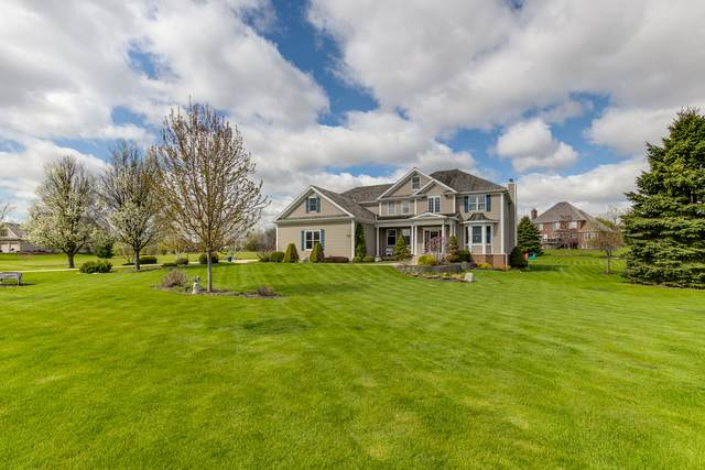8219 Country Shire Lane, Spring Grove, IL 60081 (MLS #10651377) :: Littlefield Group