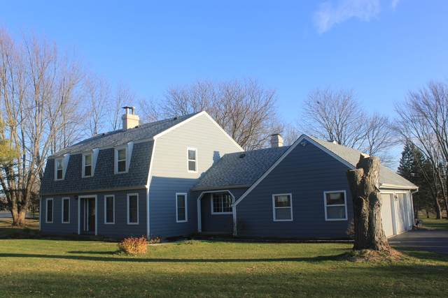 12403 Cooney Drive, Woodstock, IL 60098 (MLS #10931707) :: Jacqui Miller Homes
