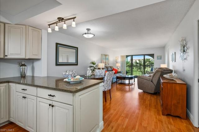 9 High Point Cir N #309, Naples, FL 34103 (#219049423) :: Equity Realty
