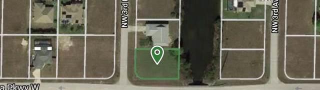 801 NW 3rd Pl, Cape Coral, FL 33993 (MLS #220003717) :: Clausen Properties, Inc.