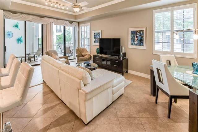 10731 Mirasol Dr #402, Miromar Lakes, FL 33913 (MLS #221025312) :: Realty Group Of Southwest Florida