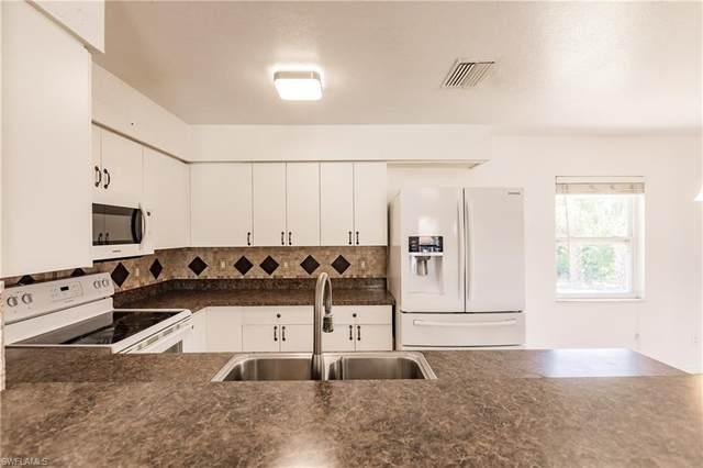 10680 Woods Cir, Bonita Springs, FL 34135 (#221039823) :: The Dellatorè Real Estate Group