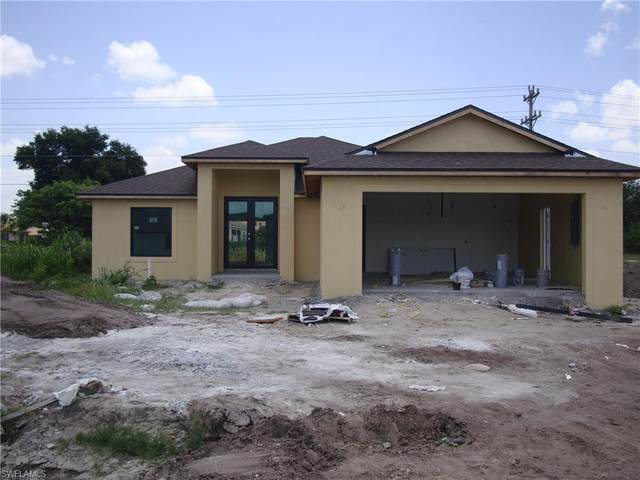 606 Morning Mist Ln, Lehigh Acres, FL 33974 (#220014711) :: The Dellatorè Real Estate Group