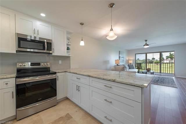 9 High Point Cir N #203, Naples, FL 34103 (MLS #220027586) :: Clausen Properties, Inc.