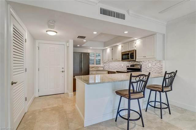 1 High Point Cir W #103, Naples, FL 34103 (MLS #220064241) :: Clausen Properties, Inc.